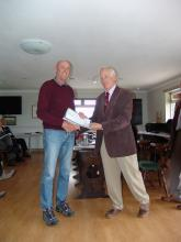 Alan Platts receiving his Level 1 umpiring certificate