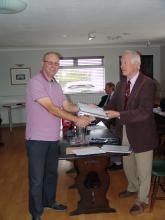 Ian Scott receiving his Level 1 certificate from Mike Smedley