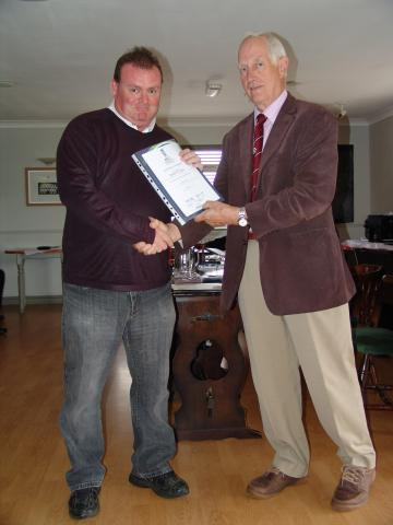 Robert Coupe receiving his Level 1 certificate from Mike Smedley