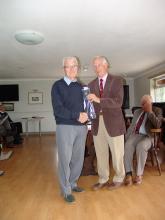 Bryn Ashley receiving his 20 year tie