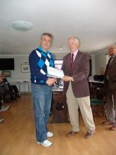 Robert Hutton receiving his Level 1 certificate from Mike Smedley